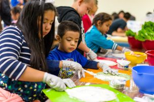 Children learning about cooking and nutrition at Sunday Friends in San Jose, CA