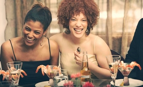 two-young-african-women-laughing-at-a-dinner-party-copy-1